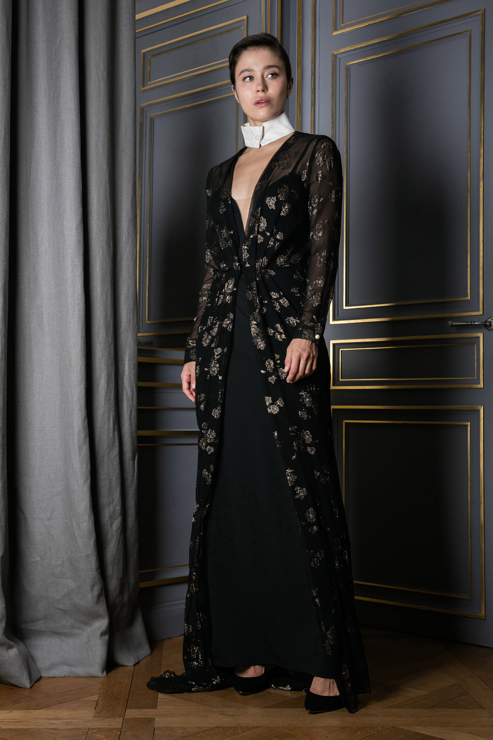 Black gown with a detachable white collar